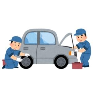 作業する車の整備士